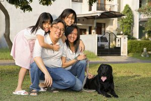 Asian family with two kids and a dog